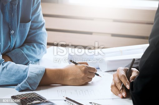 istock Confident architect female working in office with businessperson together. Concept architect team working on project. Cooperation 826130496