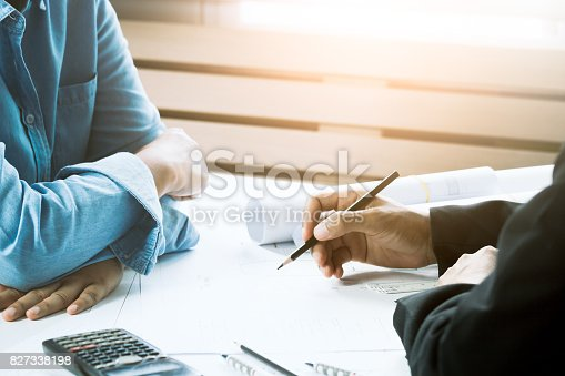 istock Confident architect female working in office with businessperson together. Concept architect team working on project. Cooperation 827338198