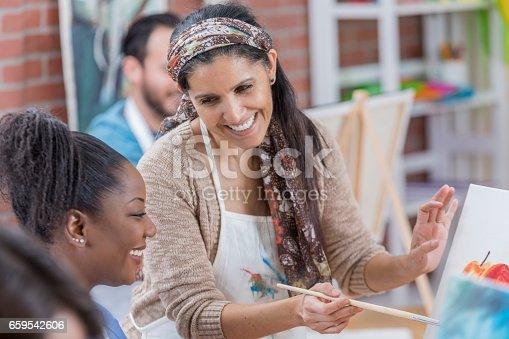 658645980 istock photo Confident artist teaches in an art studio 659542606