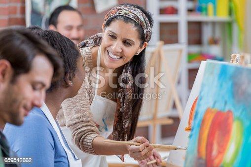658645980 istock photo Confident artist teaches painting lesson 659542662