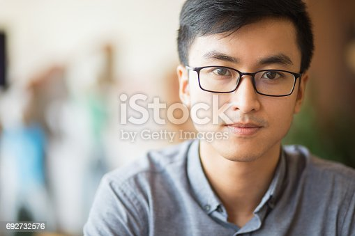 istock Confident Asian businessman in eyeglasses 692732576