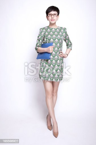 istock Confident Oriental Businesswoman Holding Files  Standing Against Isolated White Backgroud 165568922