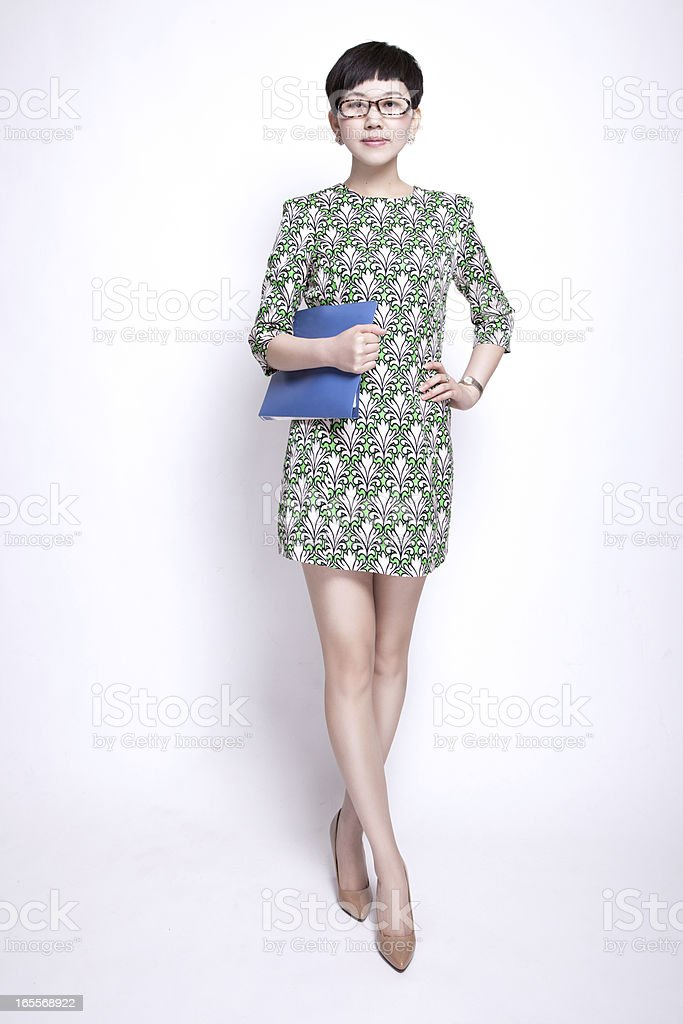 Confident Oriental Businesswoman Holding Files  Standing Against Isolated White Backgroud stock photo