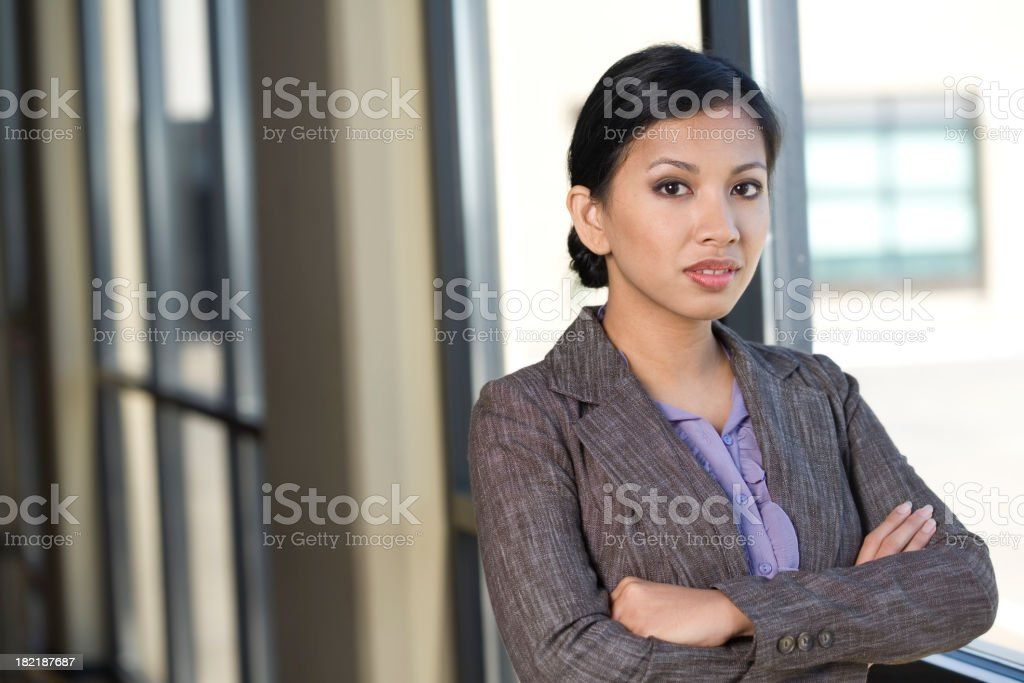 Confident Asian Businesswoman with Arms Crossed royalty-free stock photo