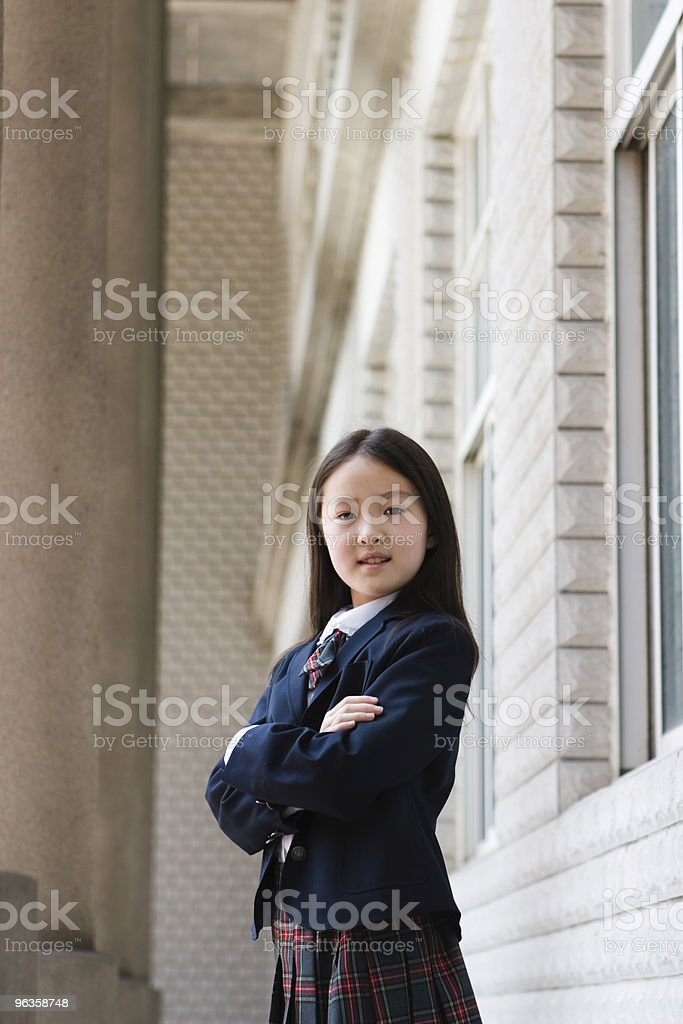 confident asian elementary schoolgirl royalty-free stock photo