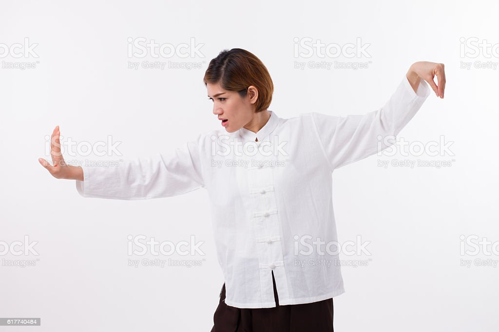 confident asian woman practice kungfu or taichi stock photo