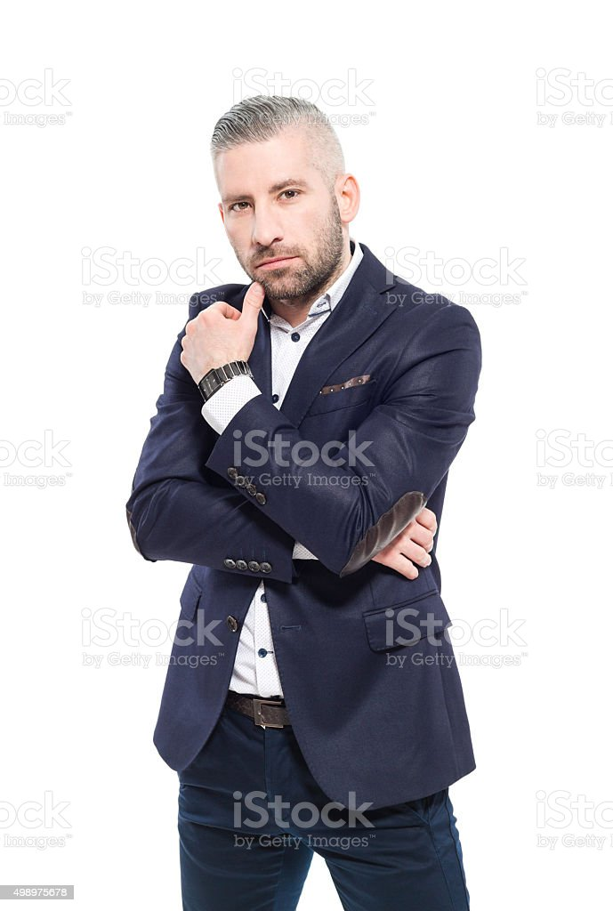 Confident bearded grey hair businessman Portrait of elegant bearded grey hair businessman, looking at camera. Studio shot, one person, isolated on white. 2015 Stock Photo
