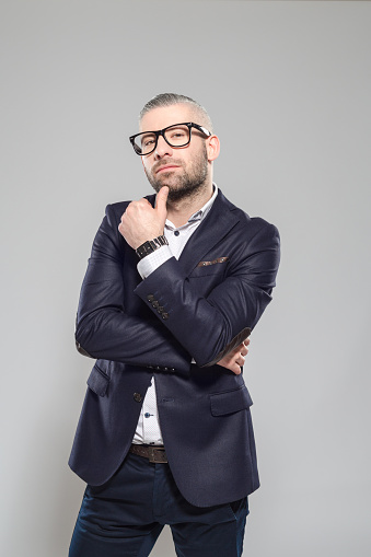 Confident Bearded Grey Hair Businessman Wearing Glasses Stock Photo - Download Image Now