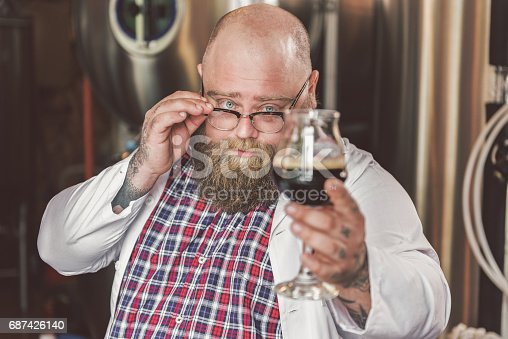 istock Confident bearded guy laboring in brew house 687426140