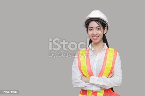 istock Confident beauty Asian woman worker posing on gray isolated background. 995480640