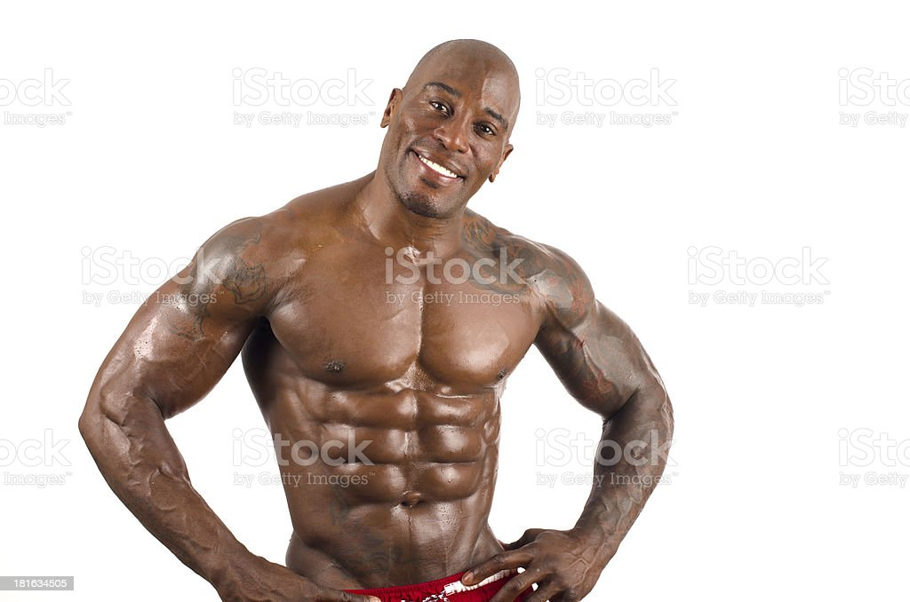 Confident black bodybuilder smiling.Strong man with perfect muscles stock photo