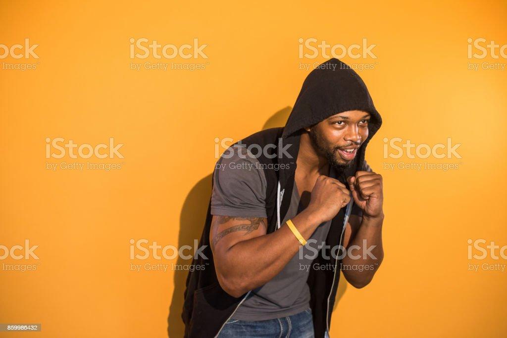 Confident Black Man on Orange Background Boxing stock photo