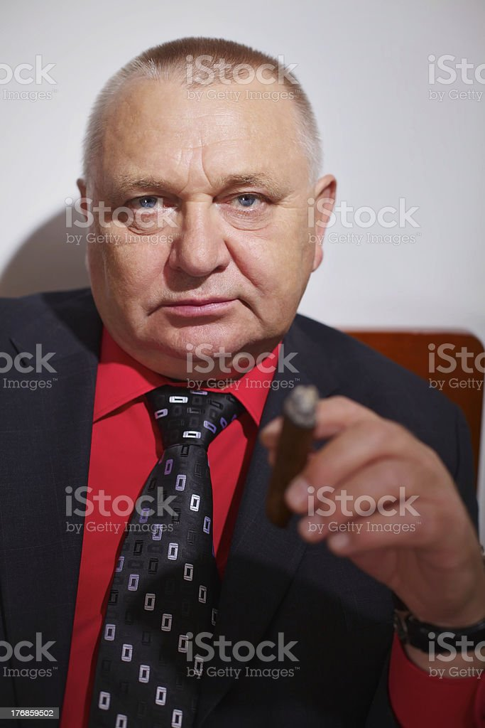 Confident boss with cigar stock photo