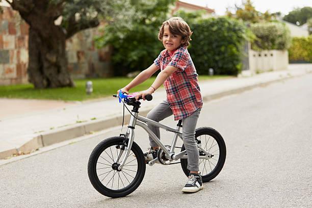 confident boy sitting on bicycle - 6 7 år bildbanksfoton och bilder