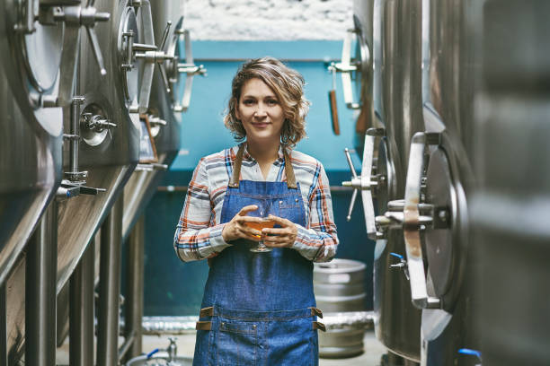 Confident Buenos Aires Craft Beer Expert Standing in Brewery stock photo
