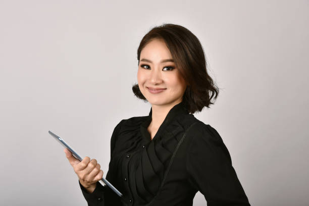 Confident business asian woman isolated in studio shot, Portrait of professional working people with copy space. stock photo