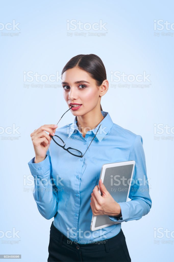 Confident business expert. Portrait of young beautiful business woman with tablet stock photo