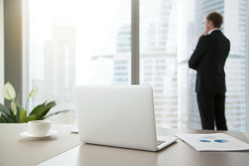 istock Confident business man contemplating in his office 628481694