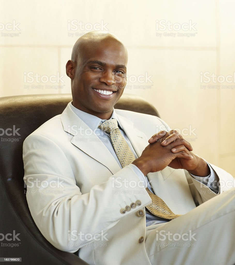 Confident business man relaxing royalty-free stock photo