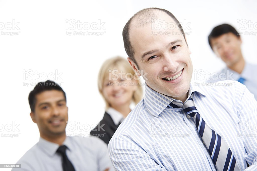 Confident Business Man Standing with Team royalty-free stock photo
