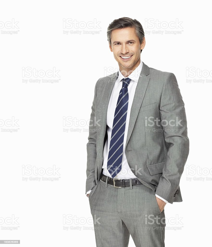 Confident business man with hands in pockets royalty-free stock photo