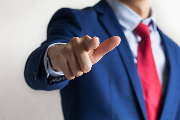 Confident business manager pointing forward as We Want You gesture stock photo