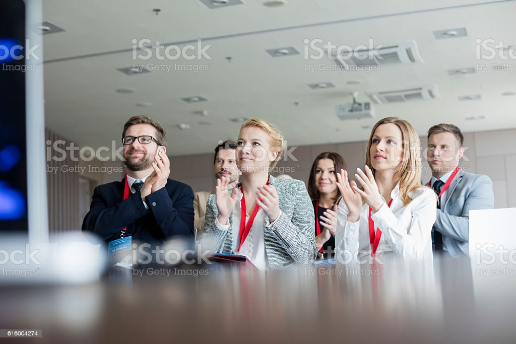 Confident business people applauding during seminar royalty-free stock photo