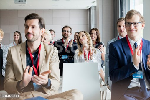 istock Confident business people applauding during seminar 616096344