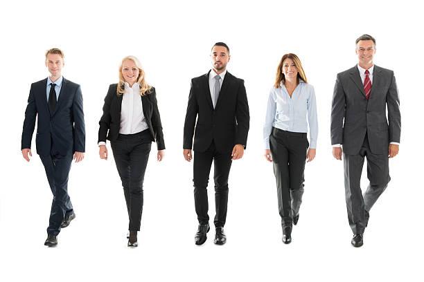 confident business people walking against white background - よそいきの服 ストックフォトと画像