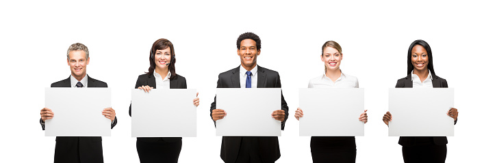 Confident Business executives with commercial signs isolated over white background