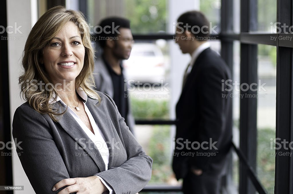 Confident Business Woman and Employees royalty-free stock photo
