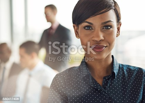 istock Confident business woman in office with group 530417408