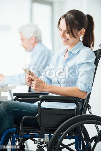 istock Confident business woman in wheelchair 905846328