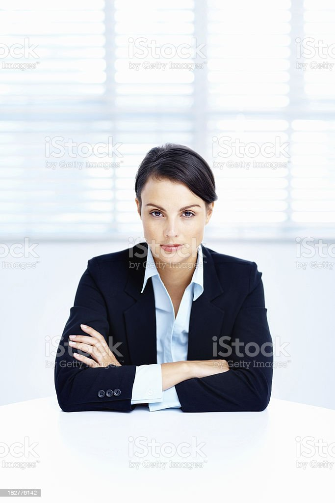 Confident business woman sitting at a table royalty-free stock photo