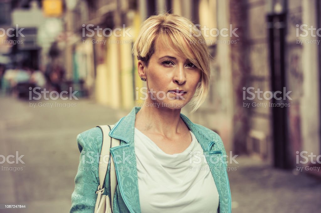 Confident business woman under the pressure stock photo