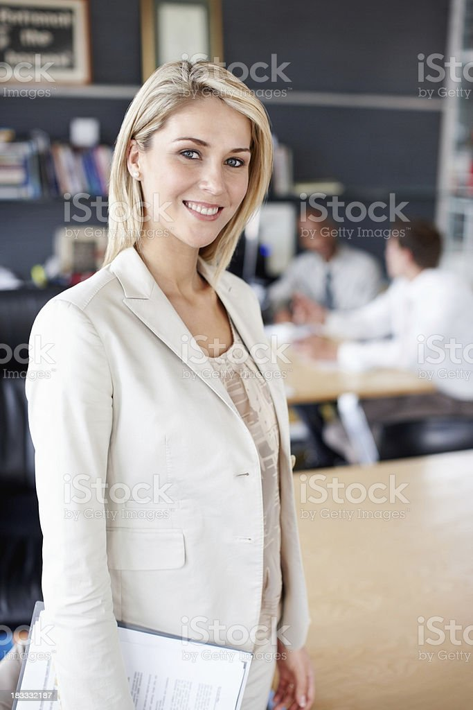 Confident business woman with coworkers in the background royalty-free stock photo