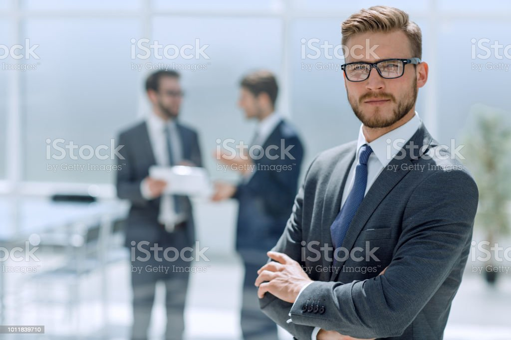 confident businessman against the background of a modern office stock photo