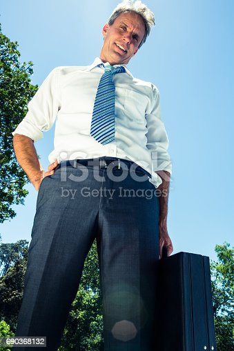 istock Confident businessman carrying briefcase 690368132
