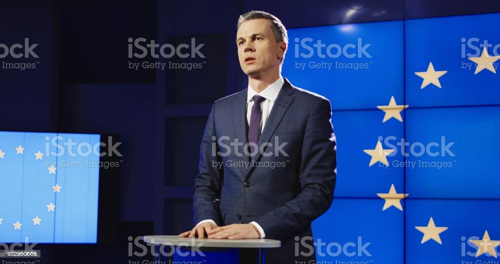 Confident businessman conducting conference in public stock photo