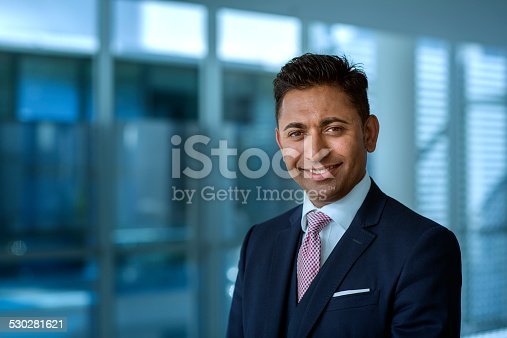 Portrait of confident businessman smiling in office