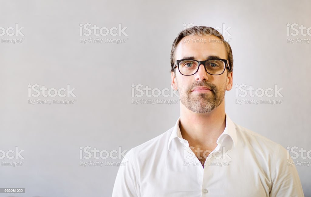 Confident businessman in office with copy space royalty-free stock photo
