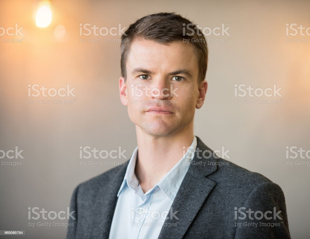 Confident businessman in office with copy space zbiór zdjęć royalty-free