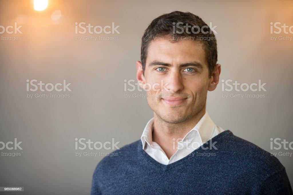 Confident businessman in office with copy space zbiór zdjęć royalty-free