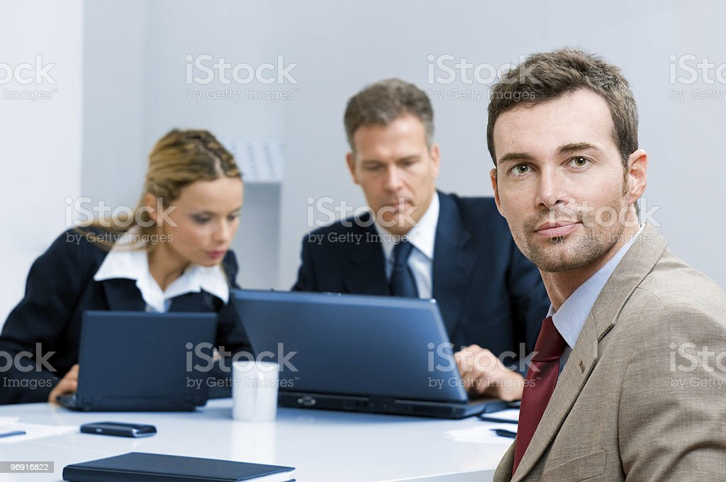 Confident businessman in the office royalty-free stock photo