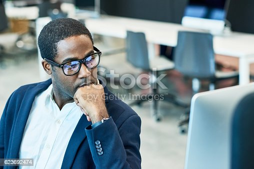 istock Confident businessman looking at computer 623692474