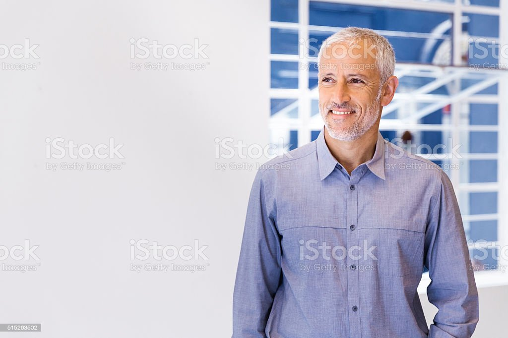 Confident businessman looking away in office stock photo