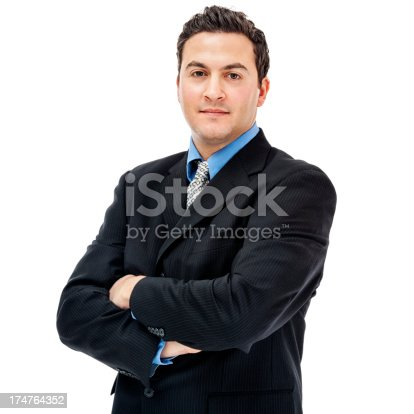 Photo of a businessman standing confidently with arms folded; isolated on white.