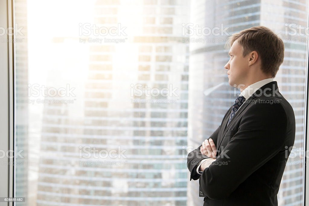Confident businessman planning new projects stock photo