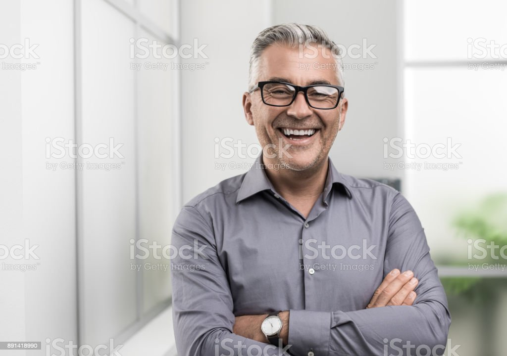 Confident businessman posing in the office stock photo