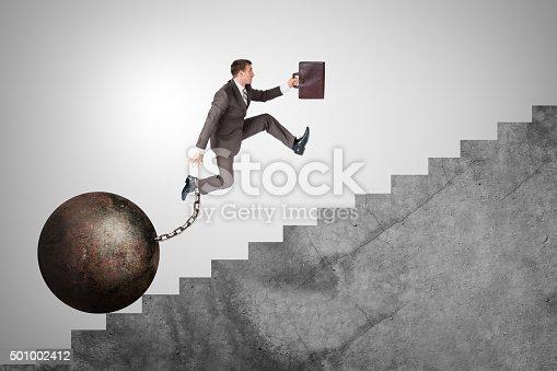 684803840istockphoto Confident businessman running upstairs 501002412